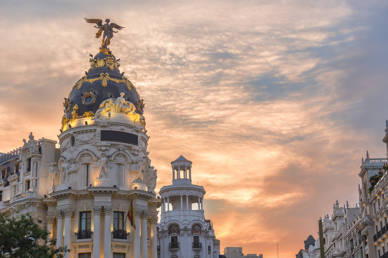 Madrid downtown in gran via main shopping street with traffic light during twilight sunset,Spain.
